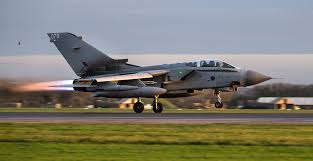 British bombers make first air strikes on Syria.